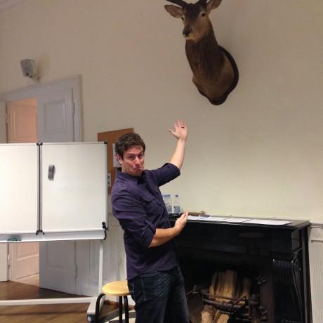 Blake teaching a communication workshop